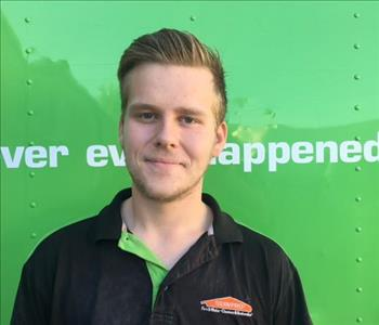 Male employee with dark blonde hair from Orange Park wearing a SERVPRO Uniform Polo shirt